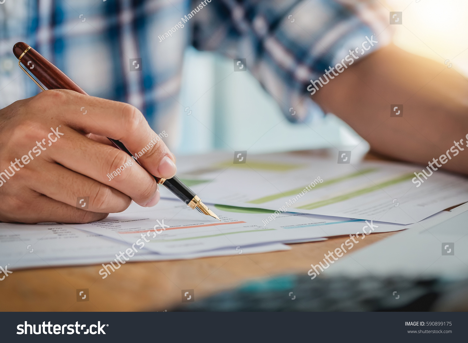 Business Man Pen Pointing Graph Chart Stock Photo (Edit Now