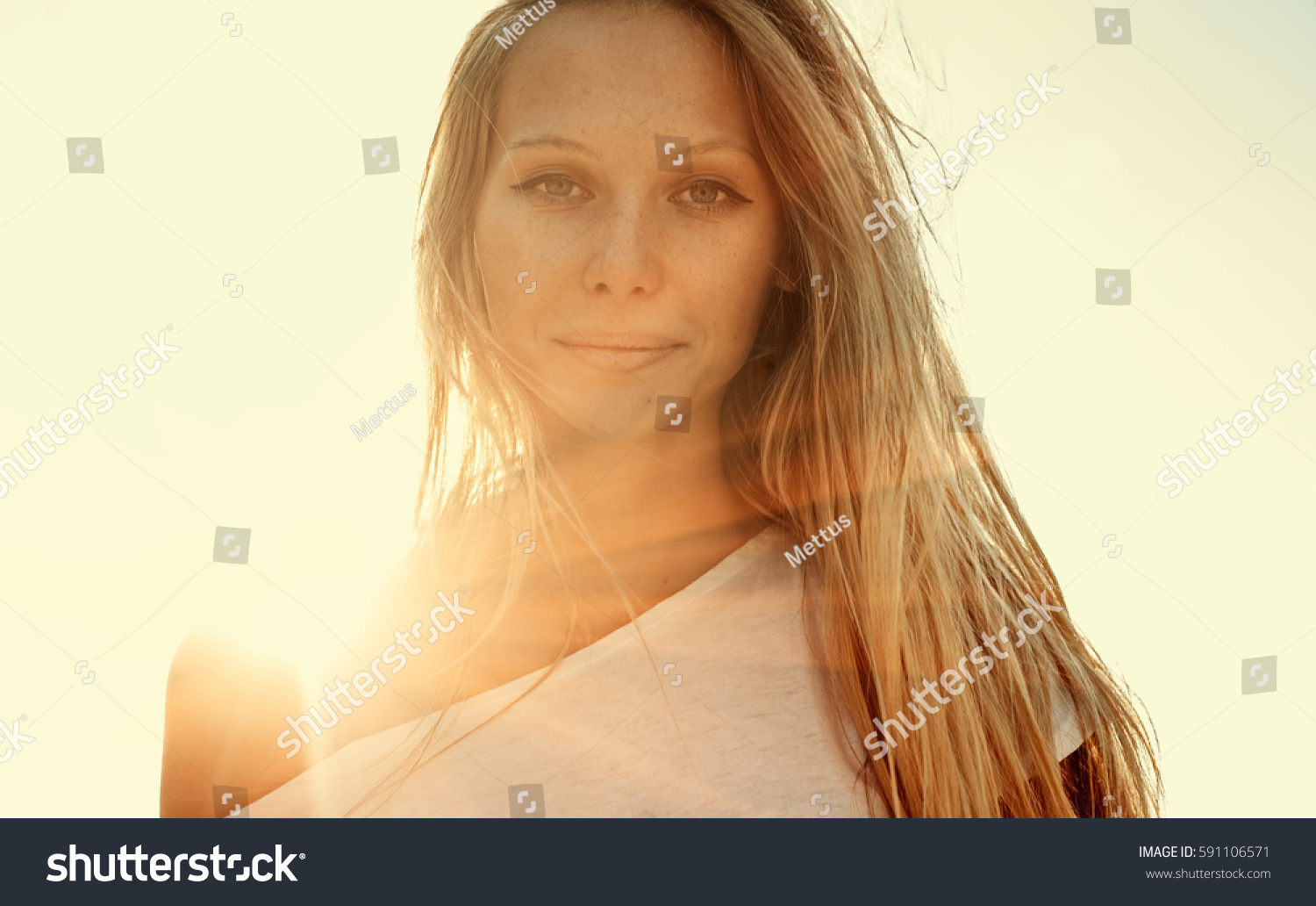 Toned image of blond haired girl blank expression retro color