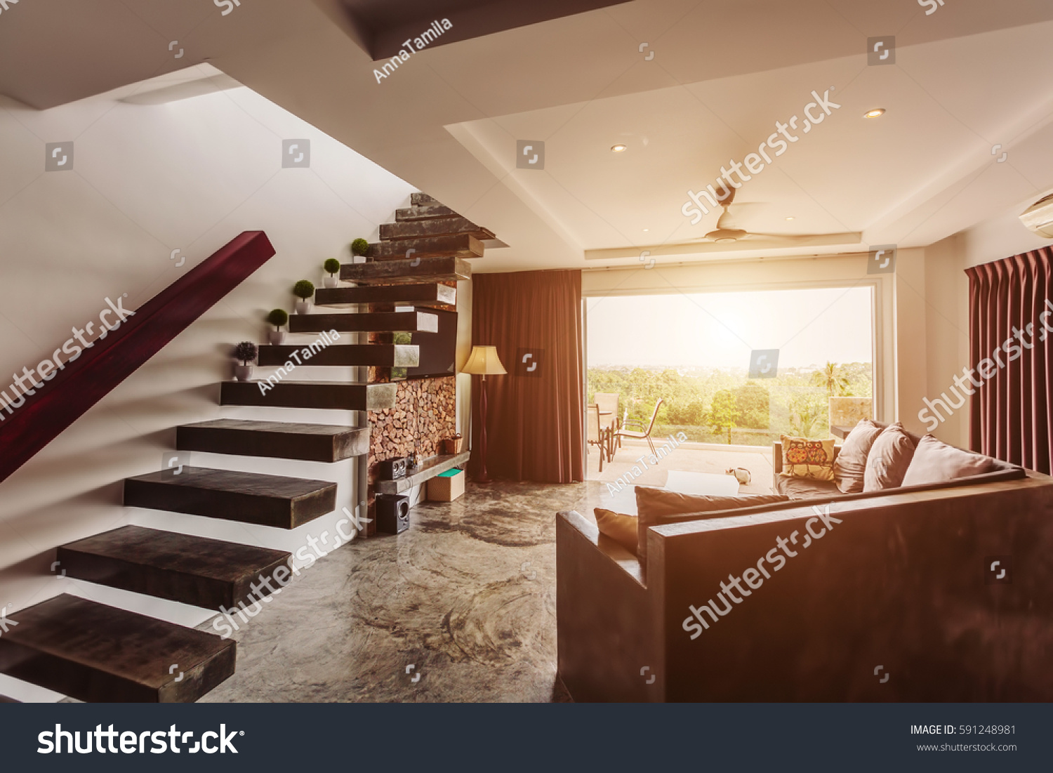 Modern Living Room Interior Design With Big Balcony, Concrete Floor And  Stairs To Second Floor