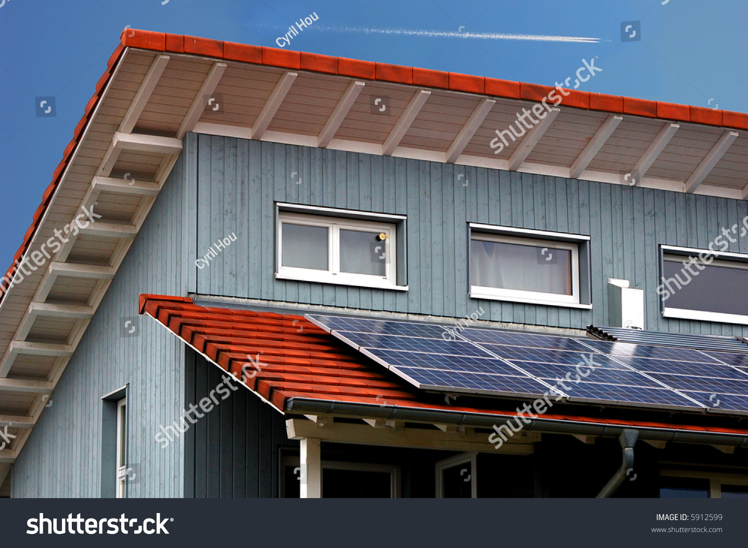Modern House With Solar Panels With Blue Sky And