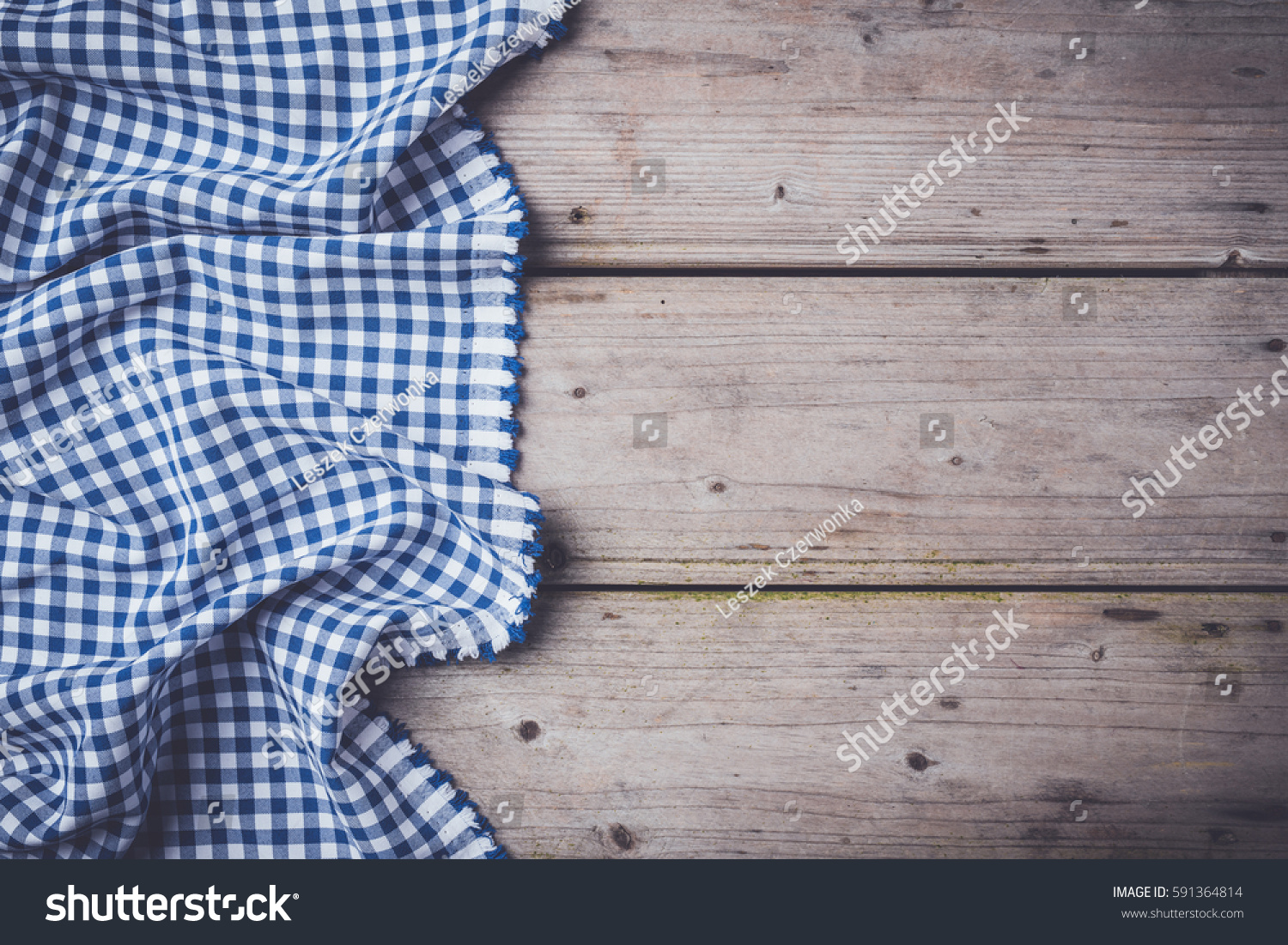 Blue Checkered Tablecloth On An Old Wooden Table
