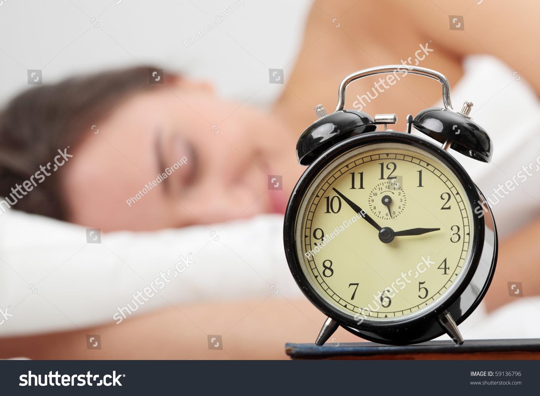 woman bed trying wake alarm clock stock photo 59136796 - shutterstock