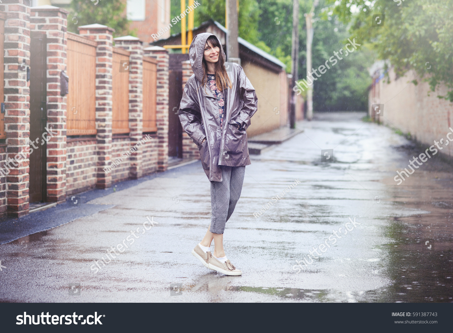 happy woman walking rain without umbrella stock photo
