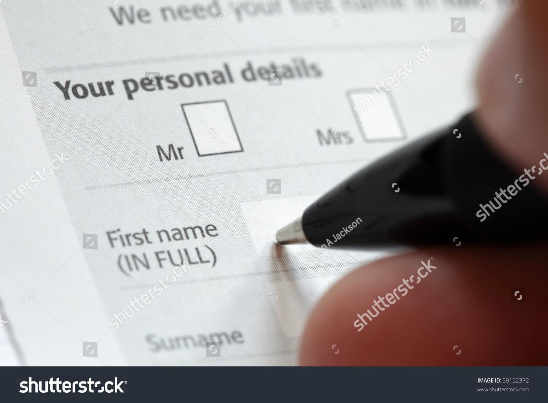 filling personal details on application form stock photo  filling in personal details on an application form