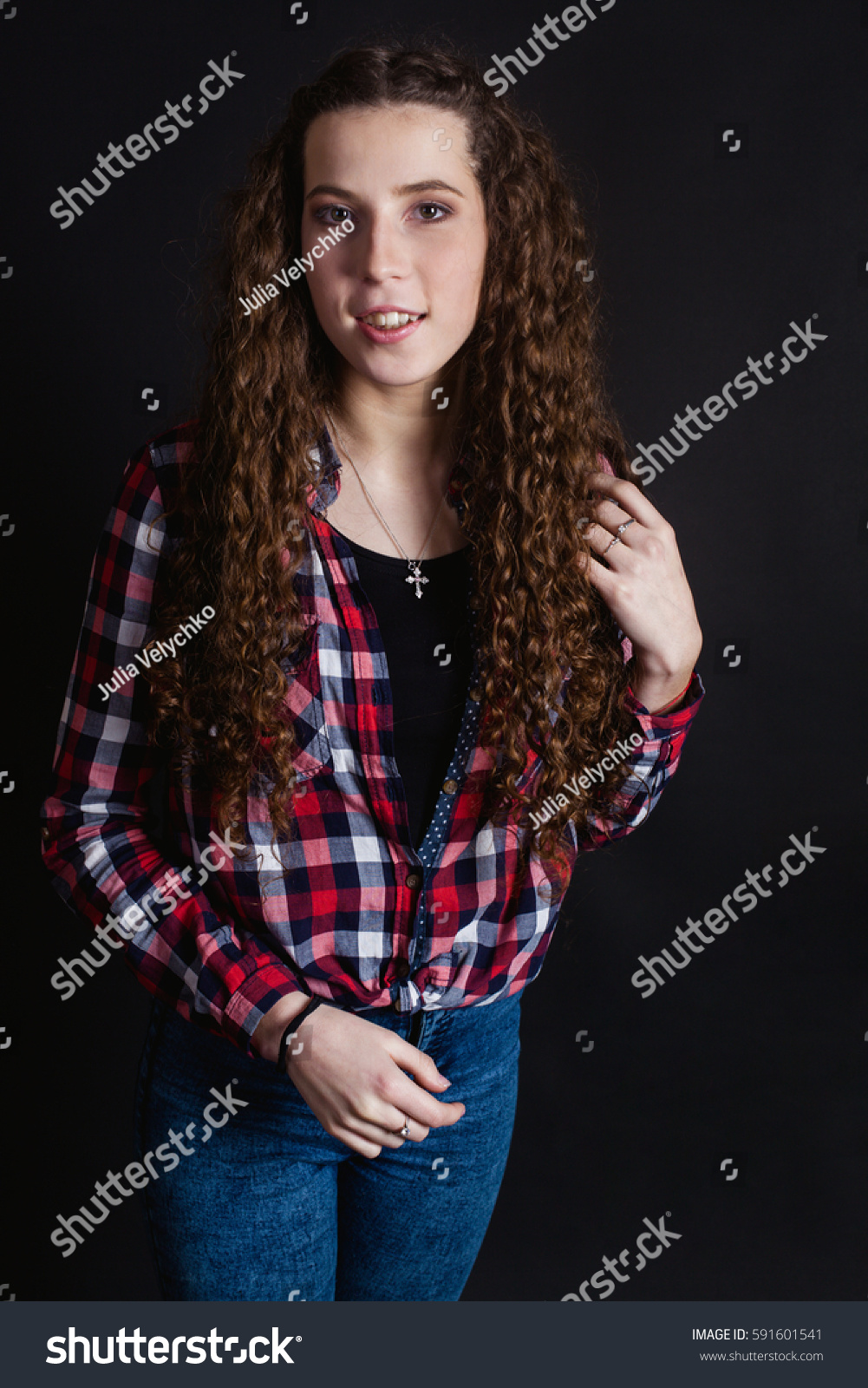 322e915c030a22 Studio portrait of beautiful thin curly… Stock Photo 591601541 ...