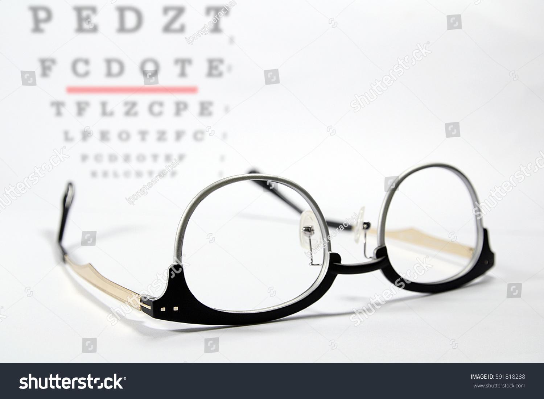 Vintage eye glasses on eye chart stock photo 591818288 shutterstock vintage eye glasses on eye chart examreading glasses nvjuhfo Image collections