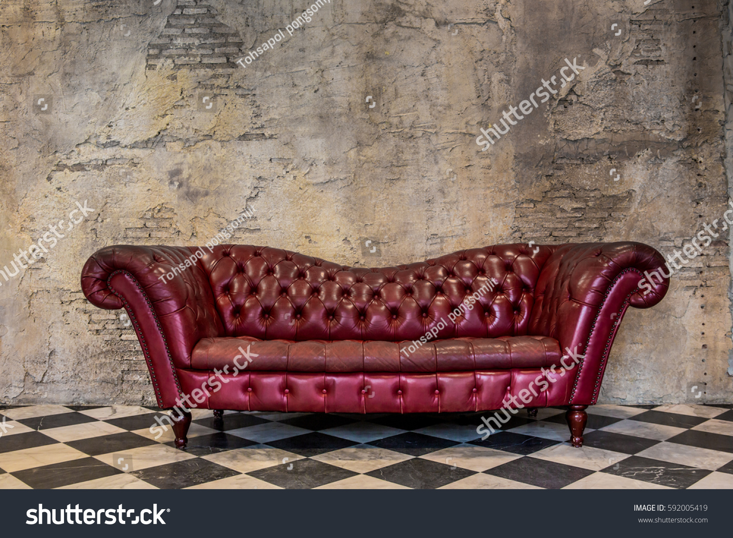 The red sofa,  The old cement wall background