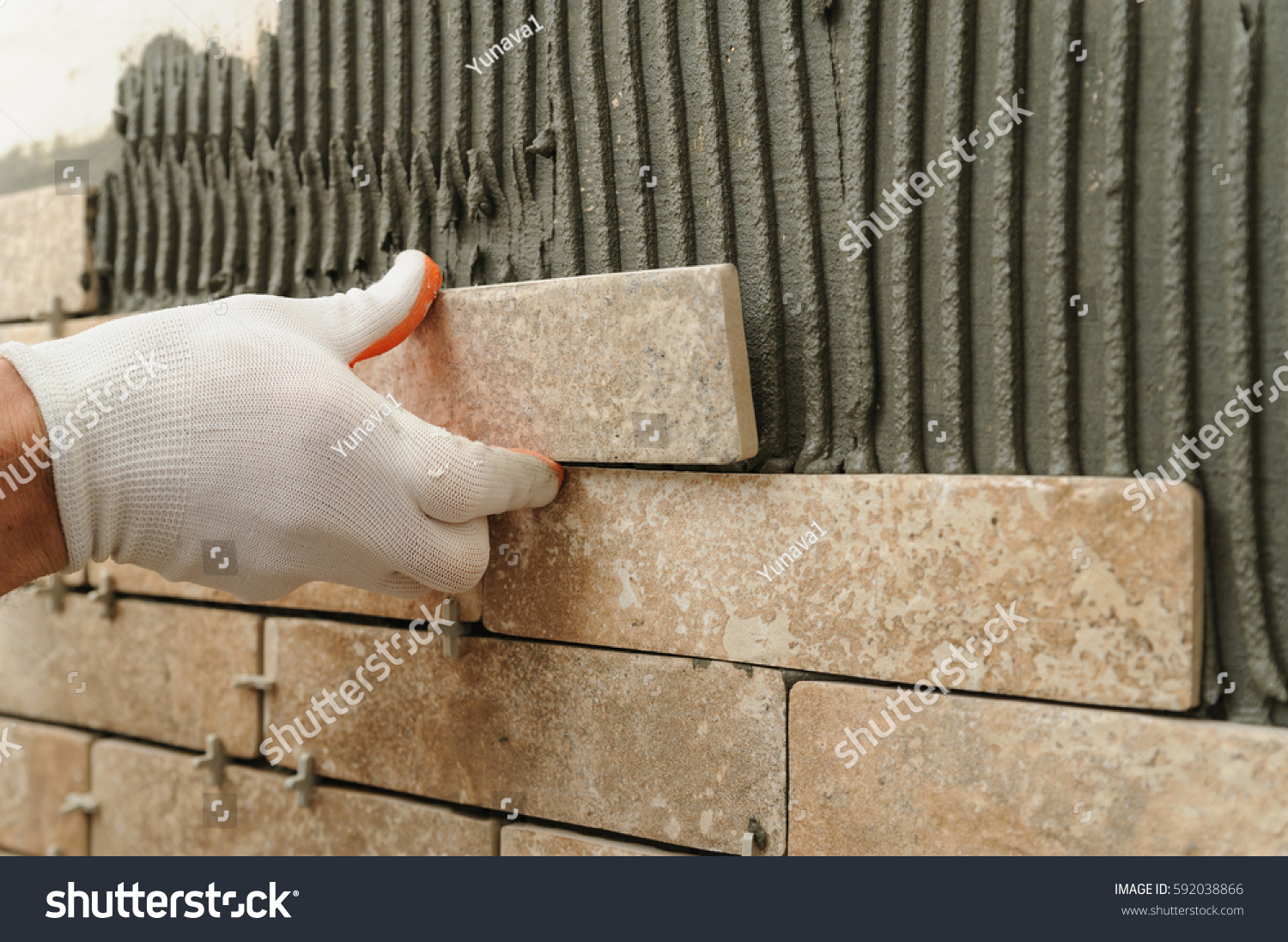 Installing Tiles On Wall Worker Putting Stock Photo (Download Now ...