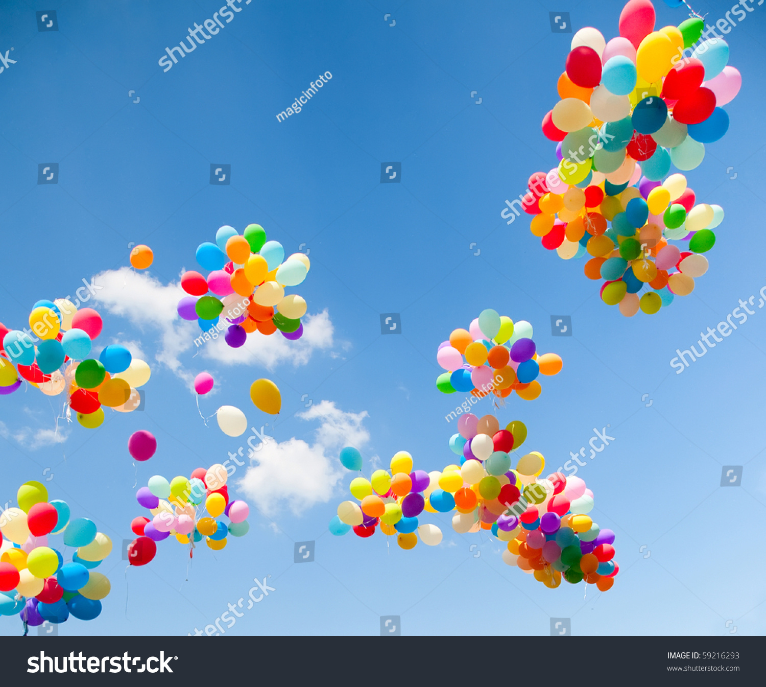 lots colorful balloons on sky background stock photo