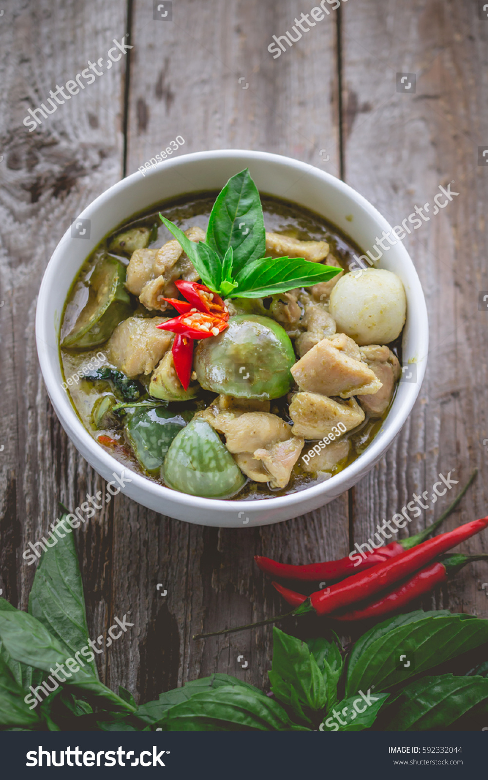 Thai chicken green curry famous thai stock photo 592332044 for Antique thai cuisine