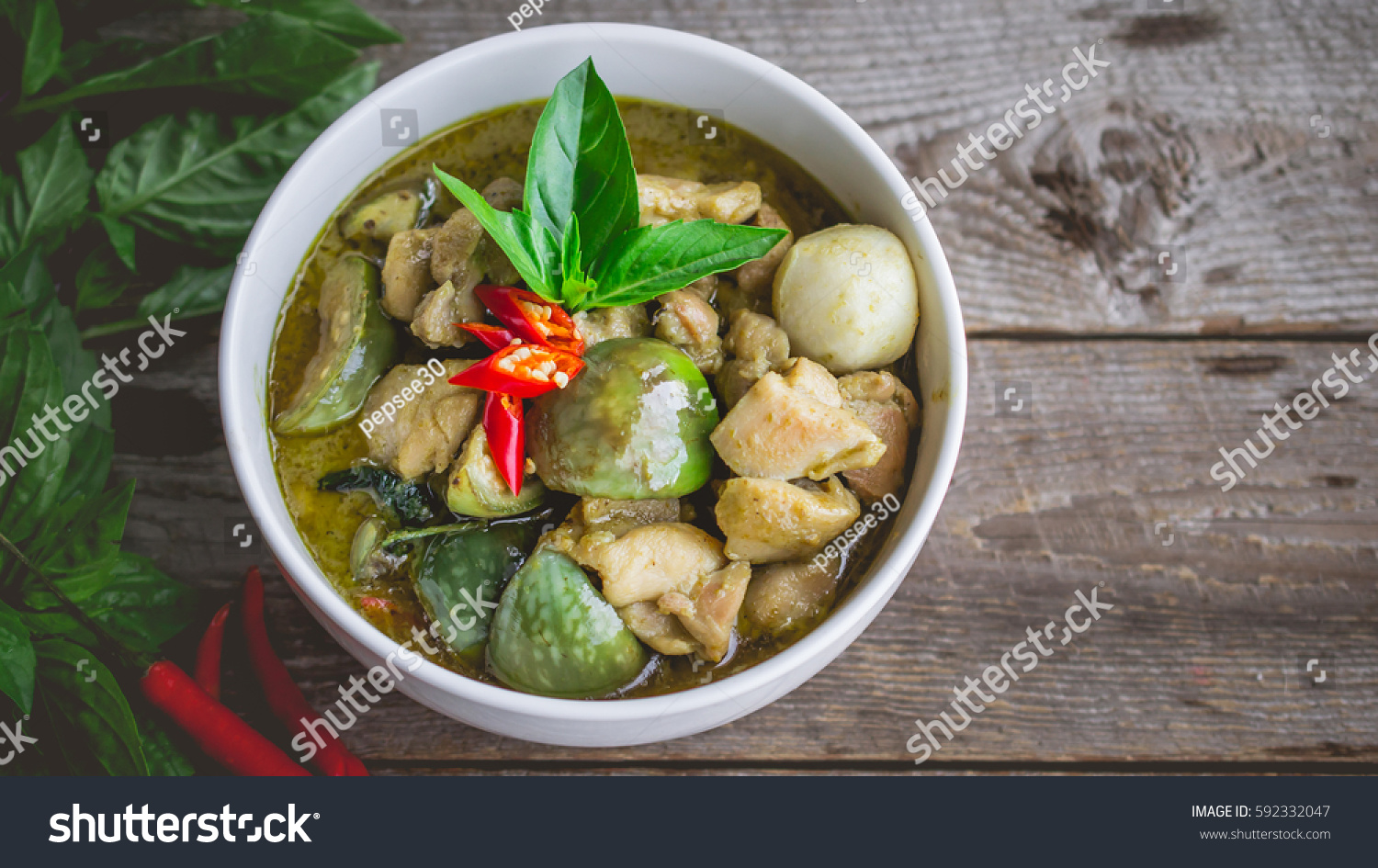 Thai chicken green curry famous thai stock photo 592332047 for Antique thai cuisine