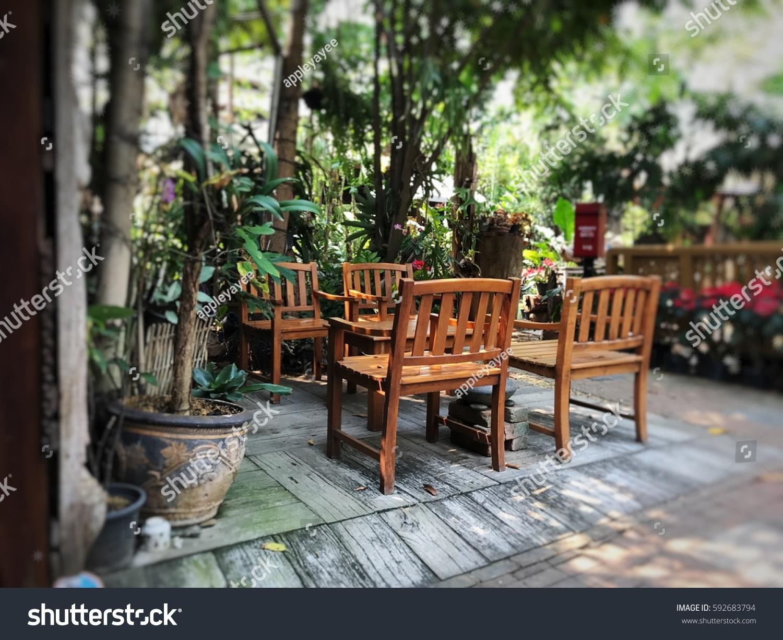 Teak wooden set for outdoor furniture in tropical garden
