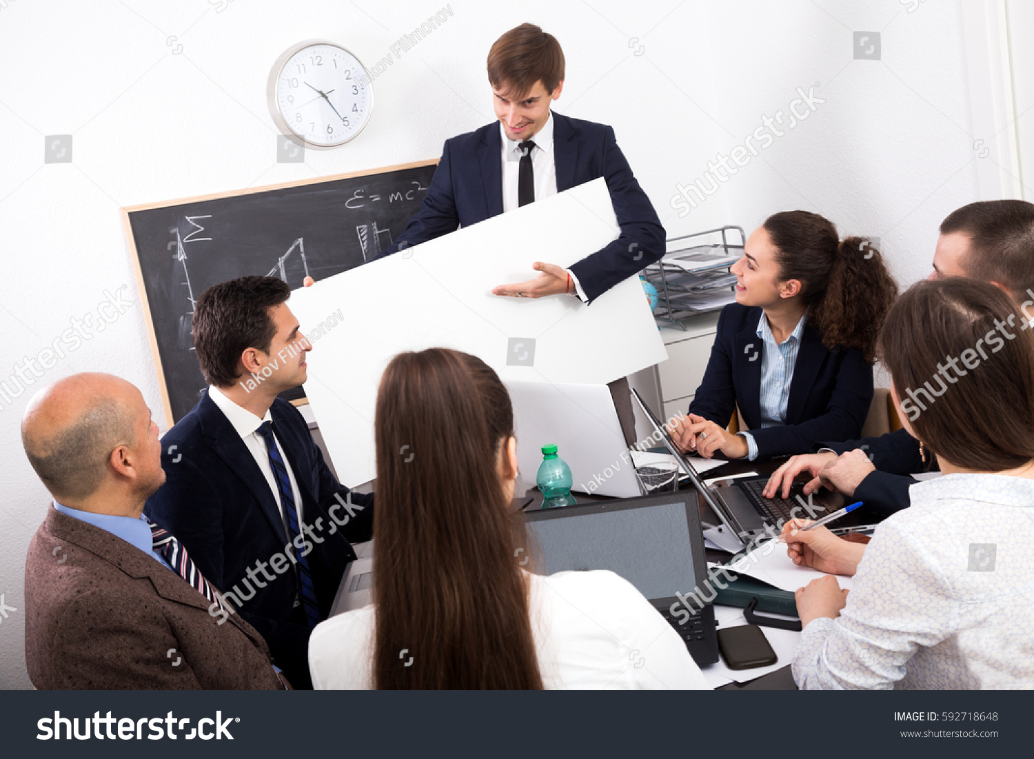 the office poster. Successful Businessman Presents New Development Plan At Poster In The Office T