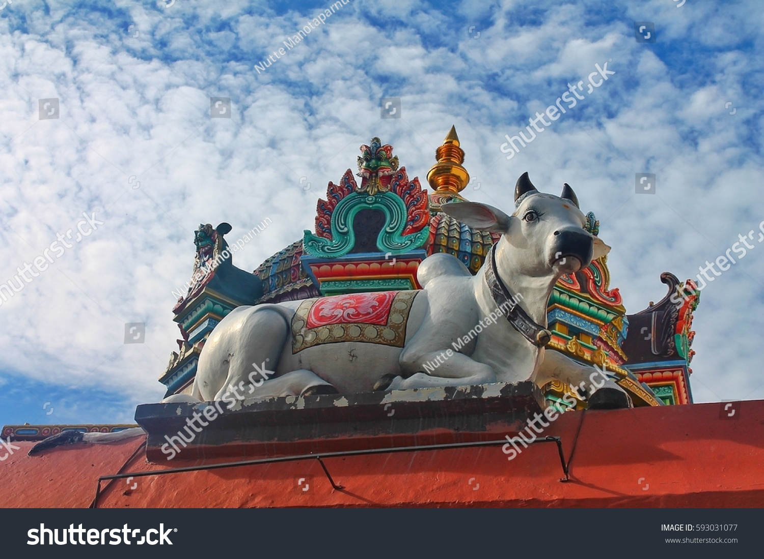 Cow statue on top door singapore stock photo 593031077 shutterstock a cow statue on the top of the door in singapore hindu temple is a one biocorpaavc Gallery