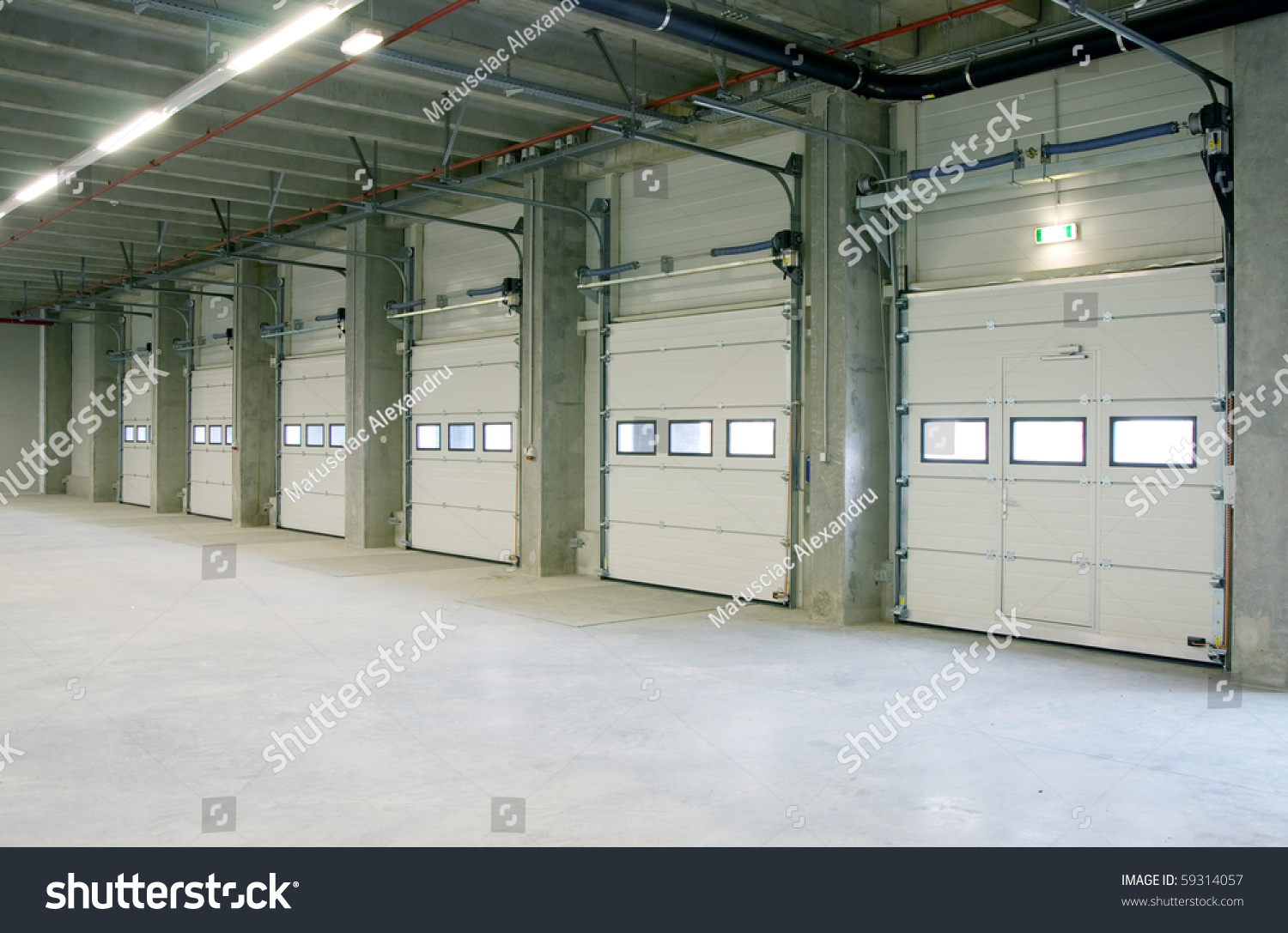 Nice Interior Of A Warehouse ,clean And Empty, Doors From Loading Docks