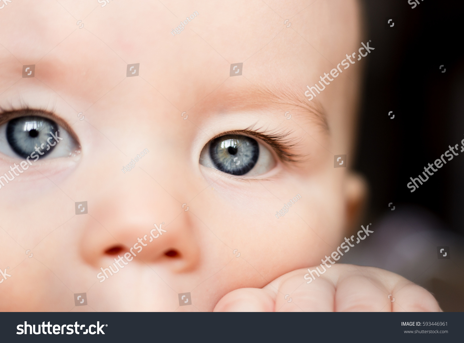 portrait sad concentrated baby babys eyes stock photo (royalty free