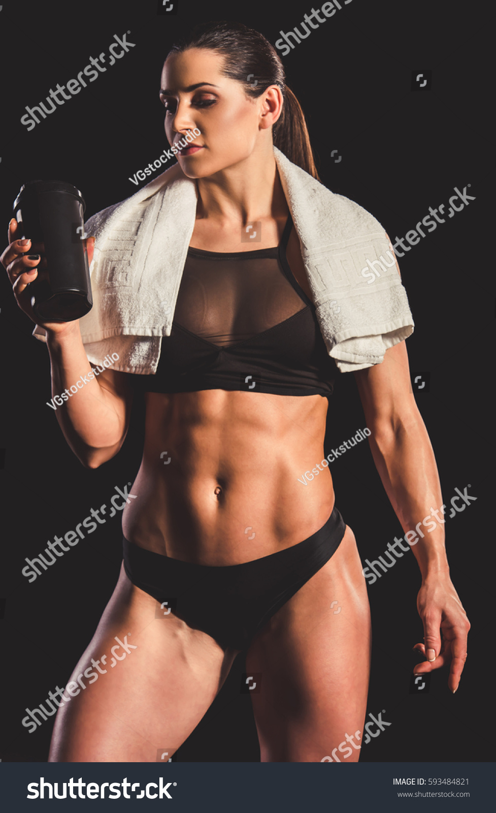 Stock photo beautiful strong muscular woman in black underwear is holding a  shaker with sport nutrition 0fd46db37