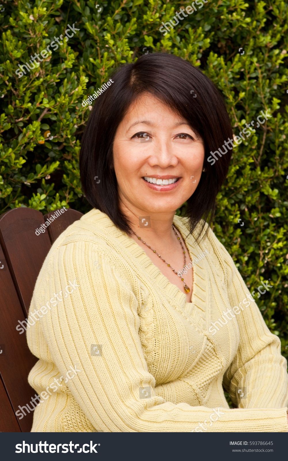 portrait mature asian woman smiling stock photo (100% legal
