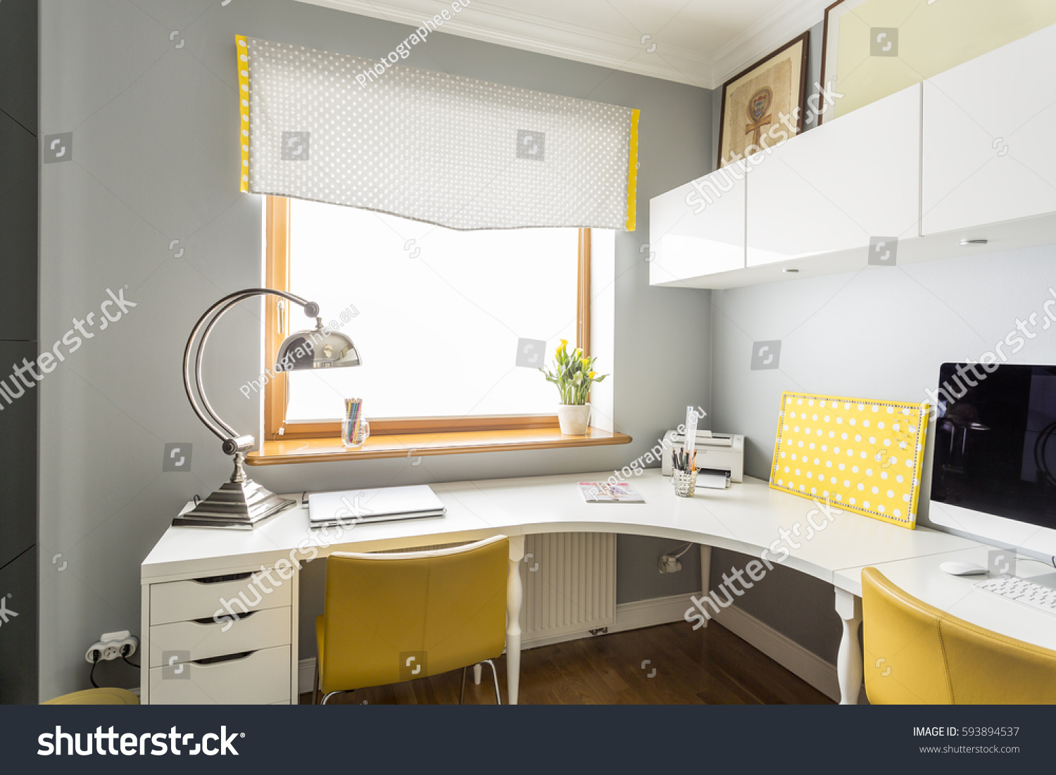 Large, Angular Desk And Hanging Cabinets In An Office Interior In White And  Yellow