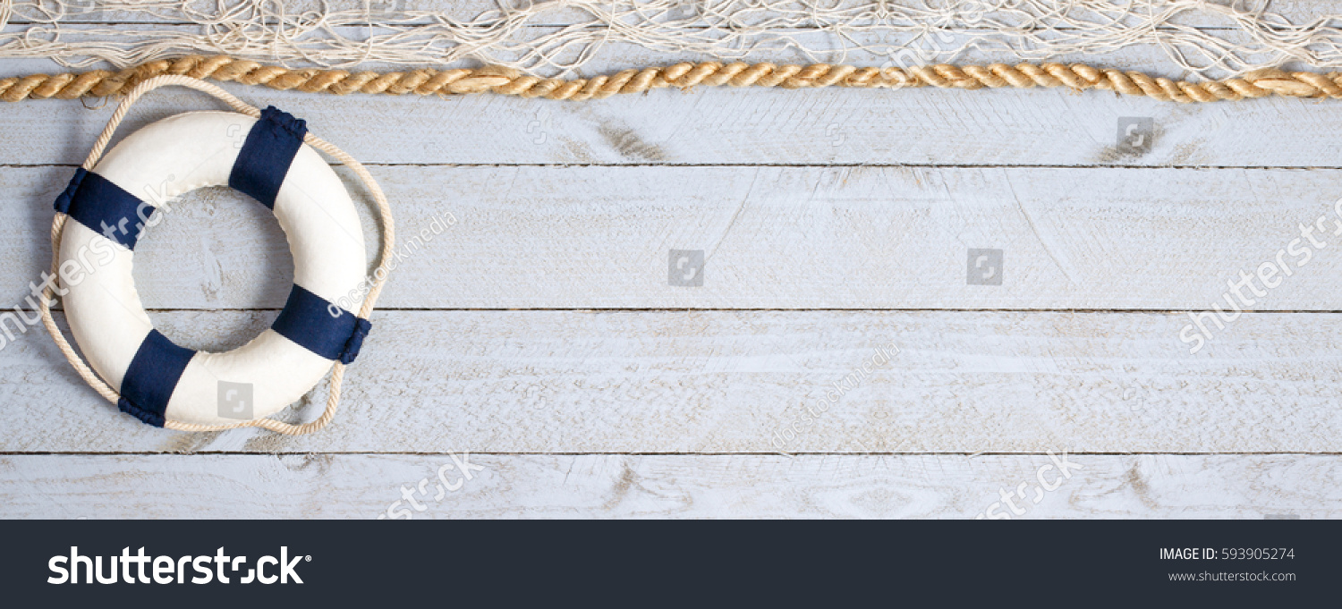 Lifebuoy on wooden background texture with rope and fishing net, copy space for individual text #593905274