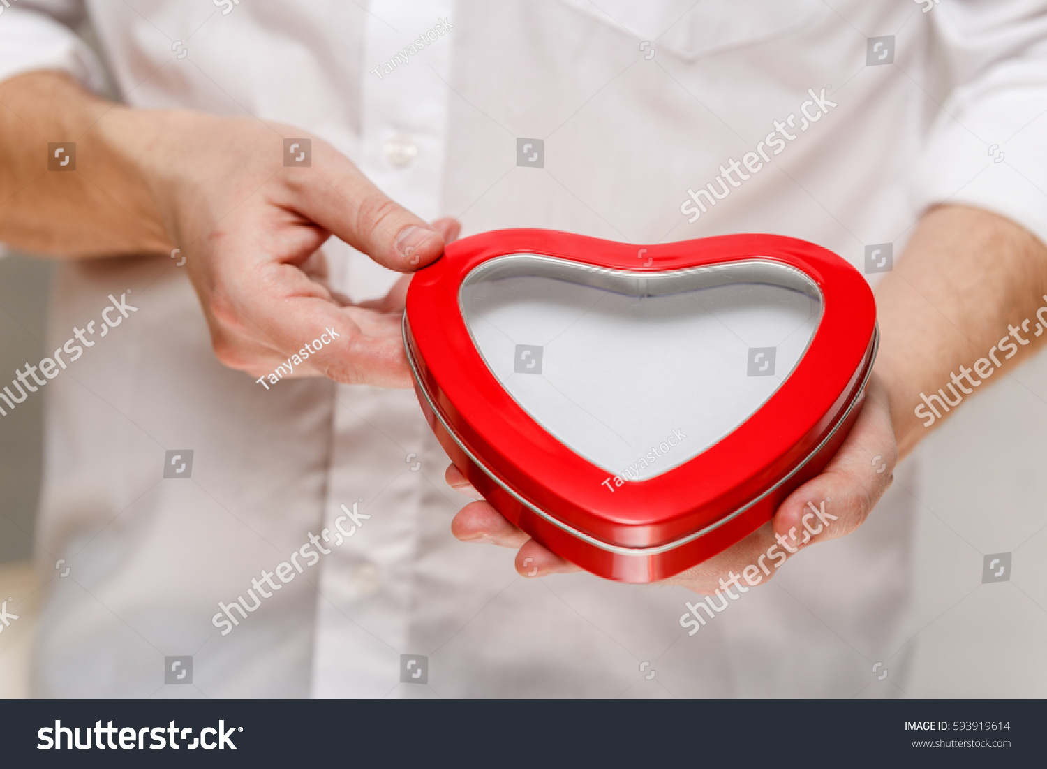Male Hands Holding Heartshaped Gift Box Stock Photo ...