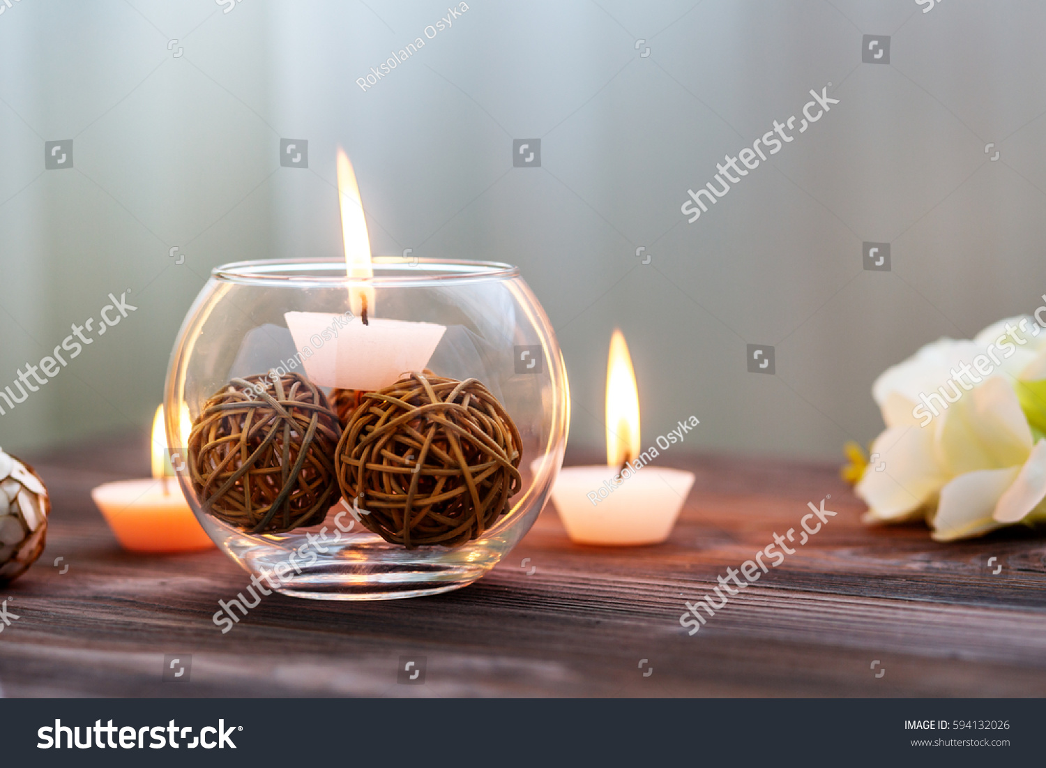 Candle glass vase decoration various interesting stock photo a candle in a glass vase decoration and various interesting elements on a dark wooden reviewsmspy