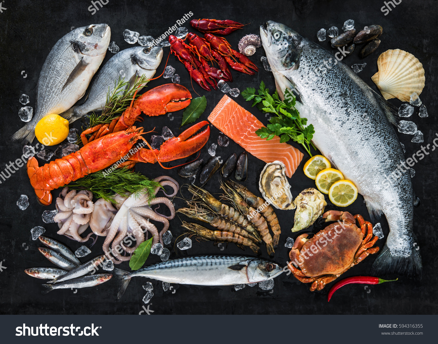 Fresh fish seafood arrangement on black stock photo for Fish and seafood