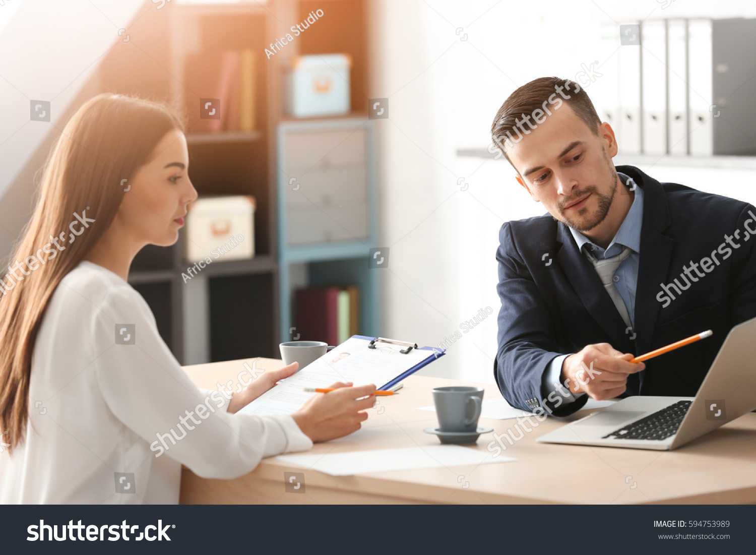 hr manager interviewing young man office stock photo
