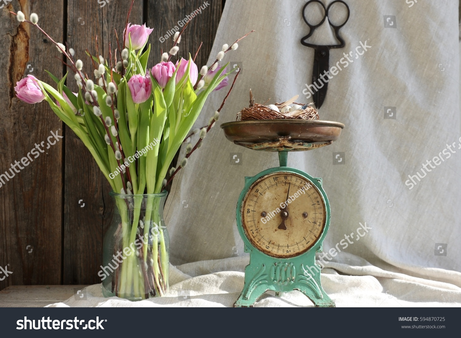 Floral scene bouquet pink tulip branches stock photo 594870725 floral scene with bouquet of pink tulip branches of willow in vintage glass jar reviewsmspy