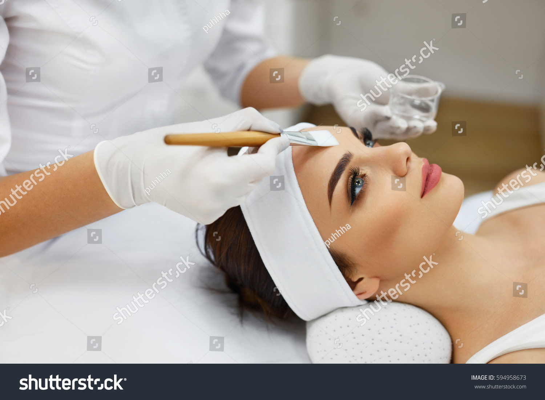 Face skin care beautician applying beauty stock photo for Skins beauty salon