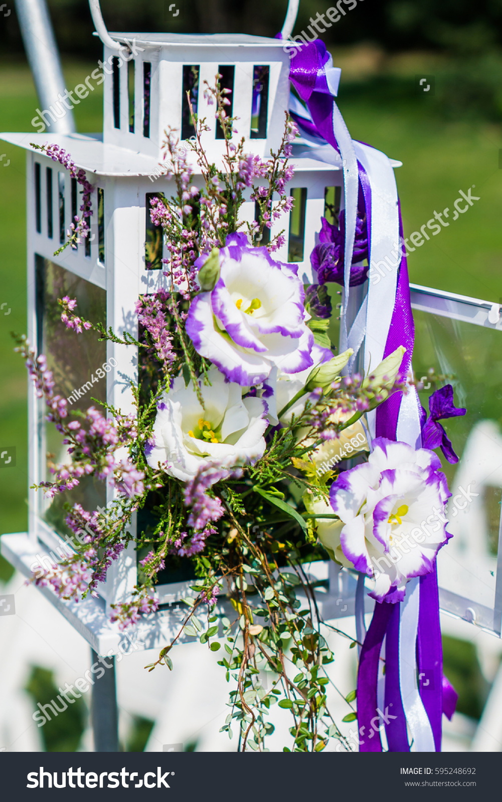 Beautiful flower wedding decoration flowers boxes stock photo beautiful flower wedding decoration flowers in the boxes with purple ribbons wedding set up junglespirit Images