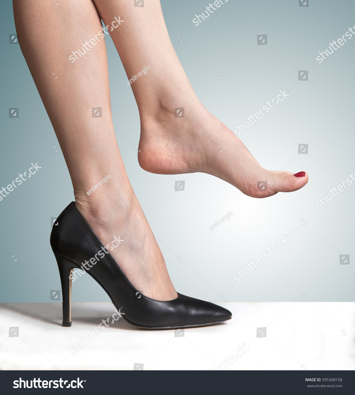 wearing high heeled shoes bare stock photo 595308158