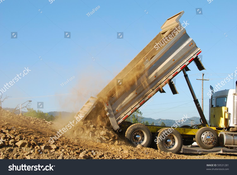 dump truck dumping rock dirt prep stock photo 59531281 shutterstock. Black Bedroom Furniture Sets. Home Design Ideas