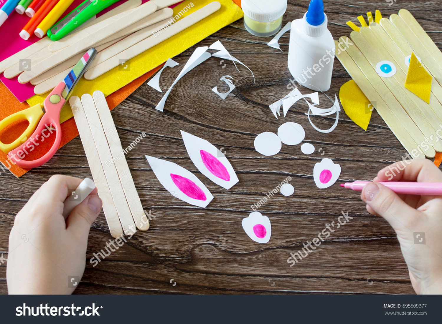 Child draws details gift items childrens stock photo 595509377 the child draws details of gift items childrens easter gift toy chicken and easter bunny negle Gallery