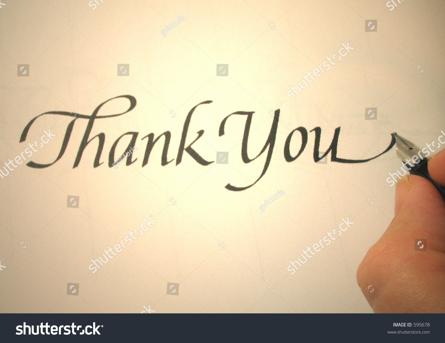 Person writing thank you in calligraphy stock photo 595678 Thank you in calligraphy writing