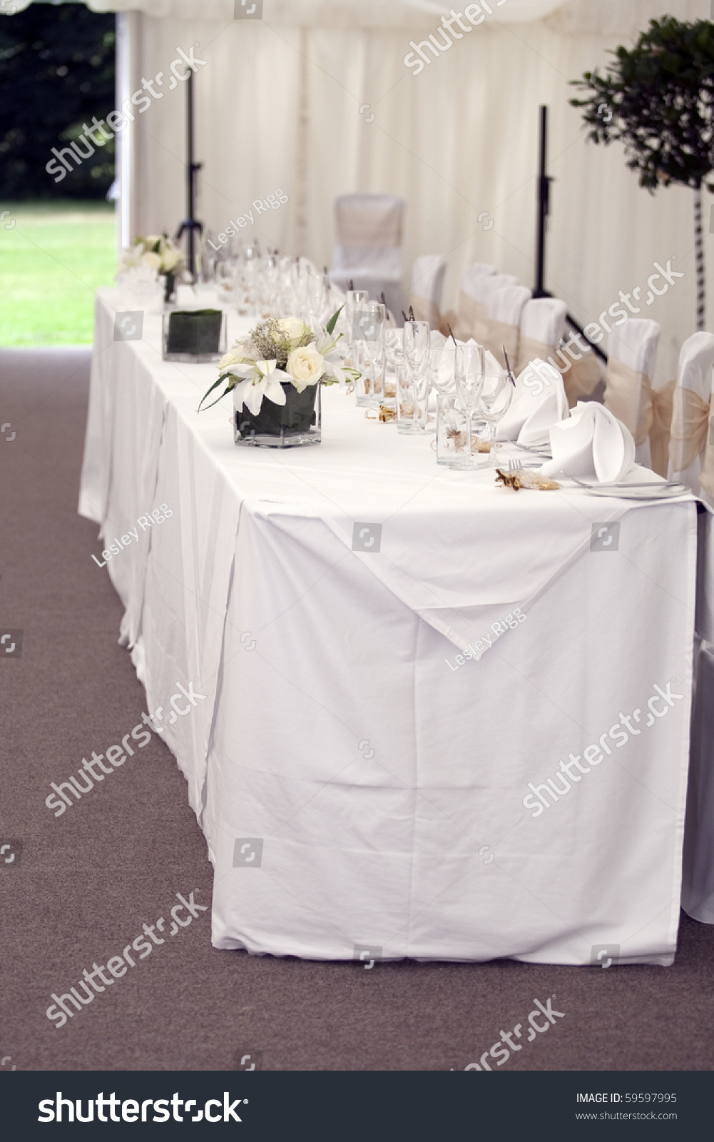 Pretty table setting in a marquee stock photo 59597995 for Pretty html table