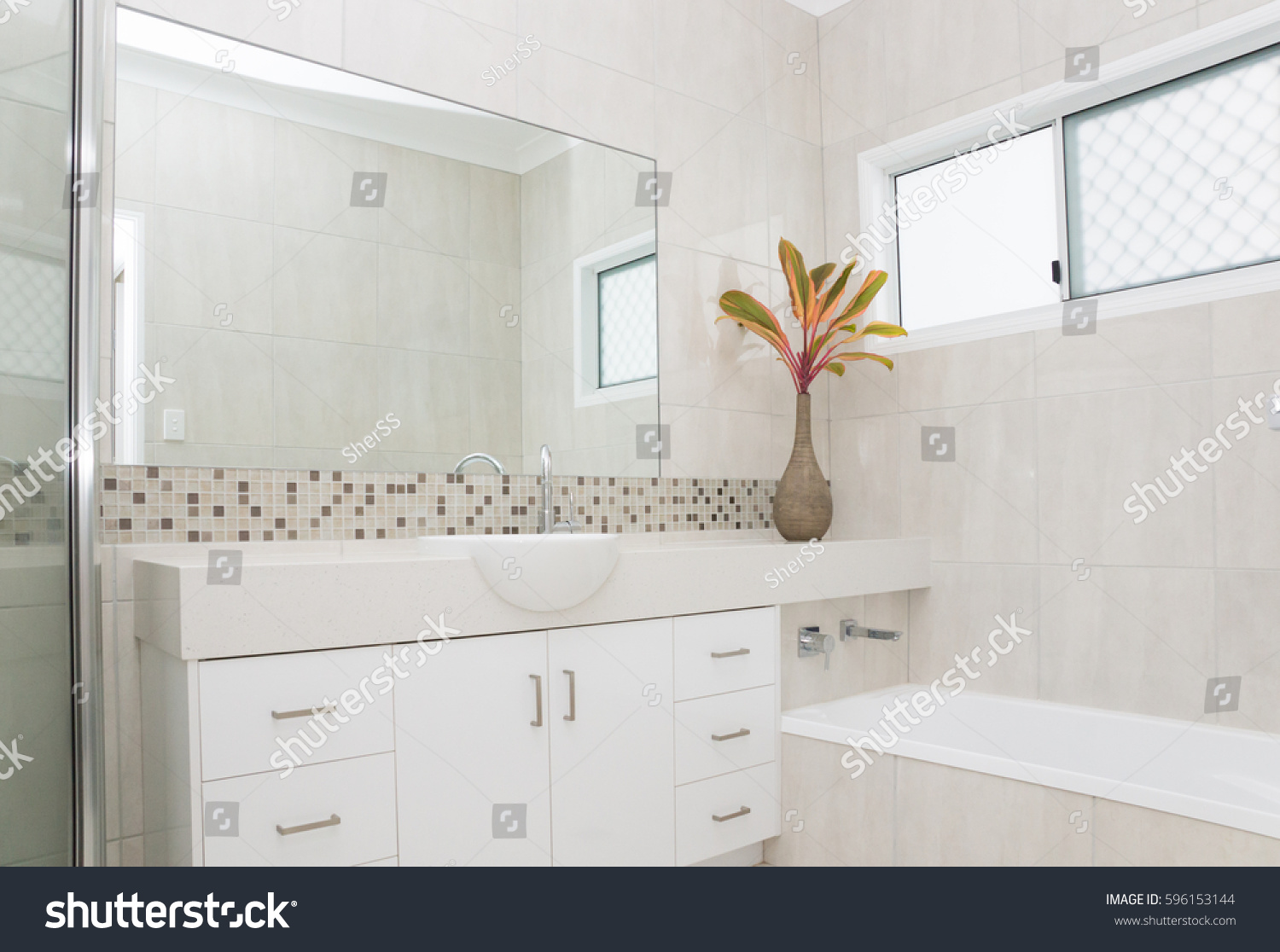 Modern bathroom with granite bench and tiled walls | EZ Canvas
