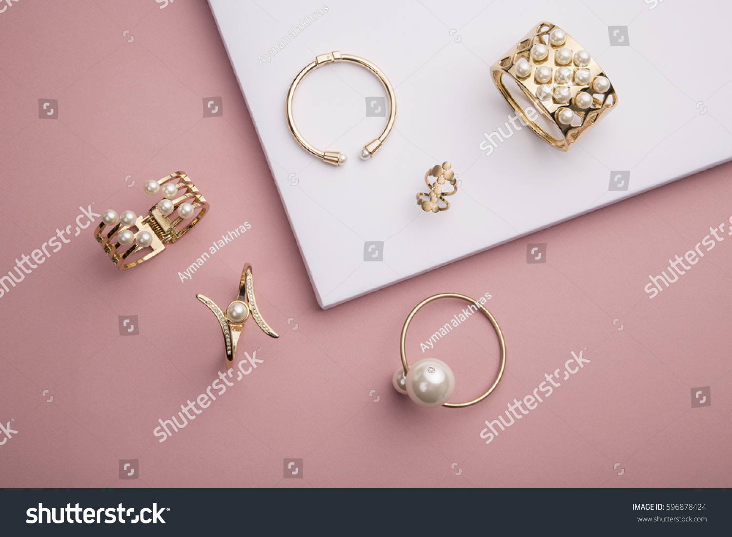 Pearl Golden Bracelets Ring On Pink Stock Photo (Royalty Free ...