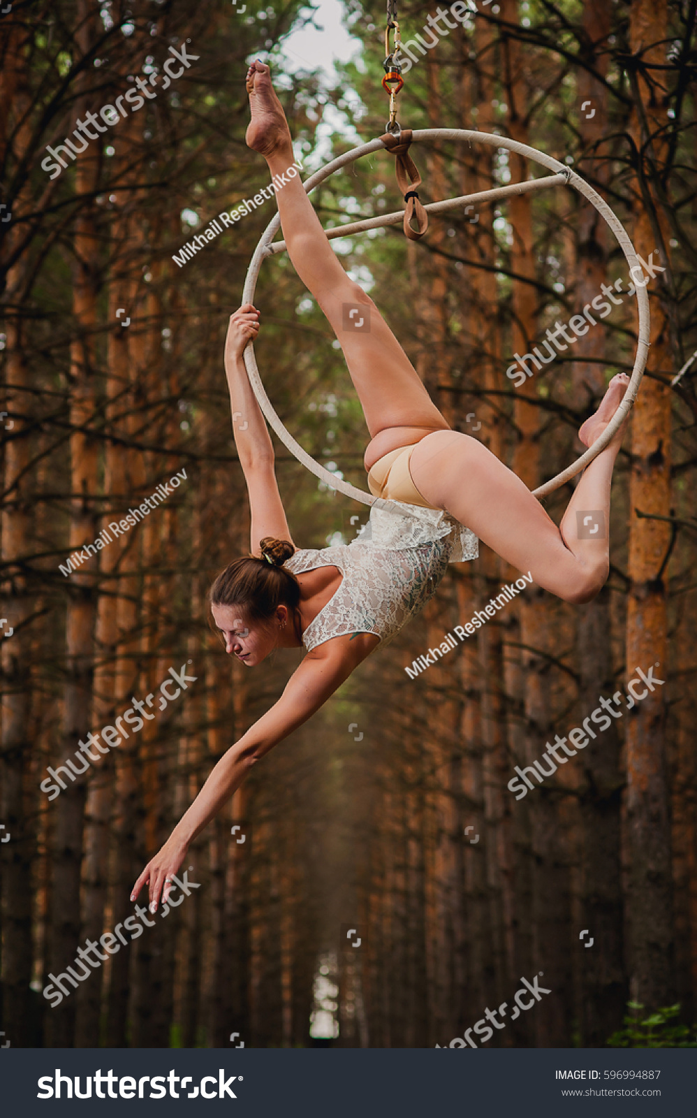 Beautiful Slim Gymnast Doing Difficult Exercises Stock Photo ...