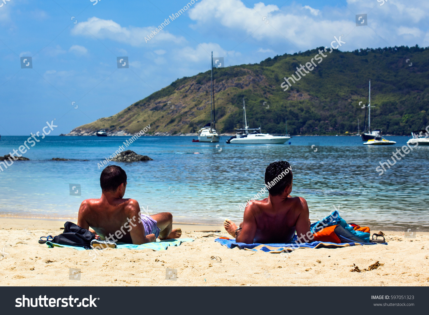 Gay Men Couple Tanning On The Beach Two Men Lying On The Beach Taking Sunbath
