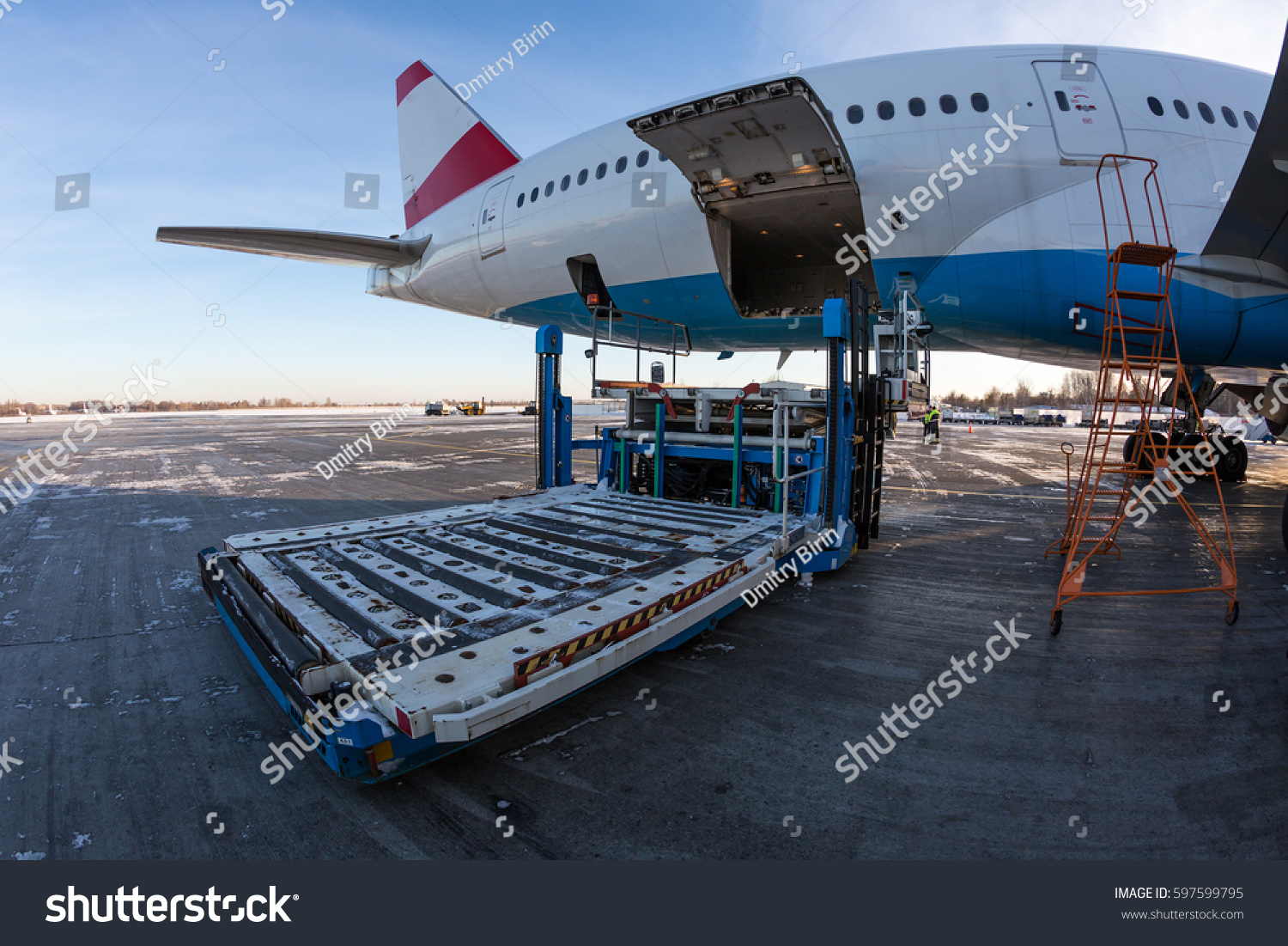 Airport cargo loading vehicle. Ground handling. Boeing 777.
