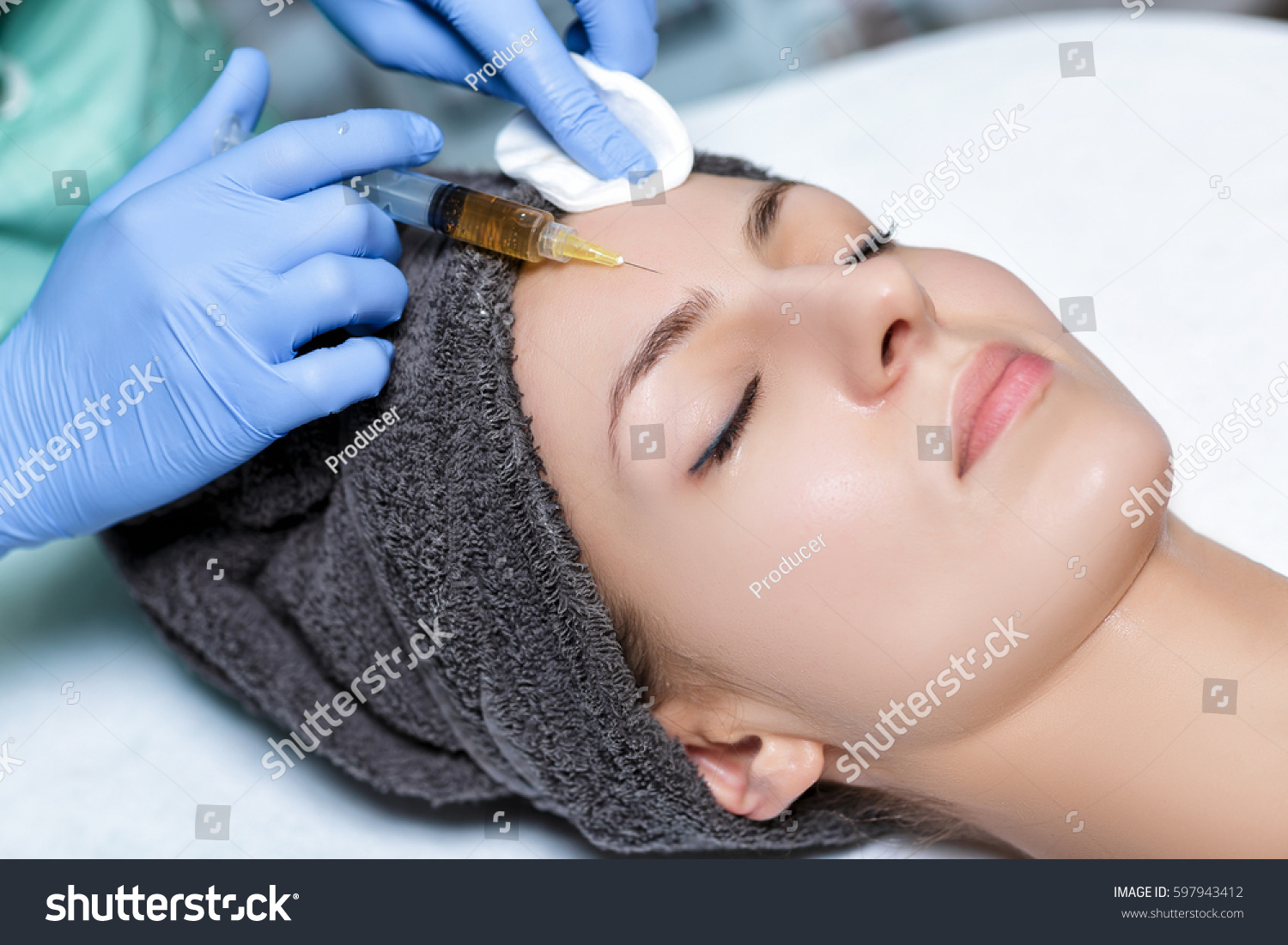 procedure Plasmolifting injection. plasma injection into the skin of the forehead of the patient #597943412