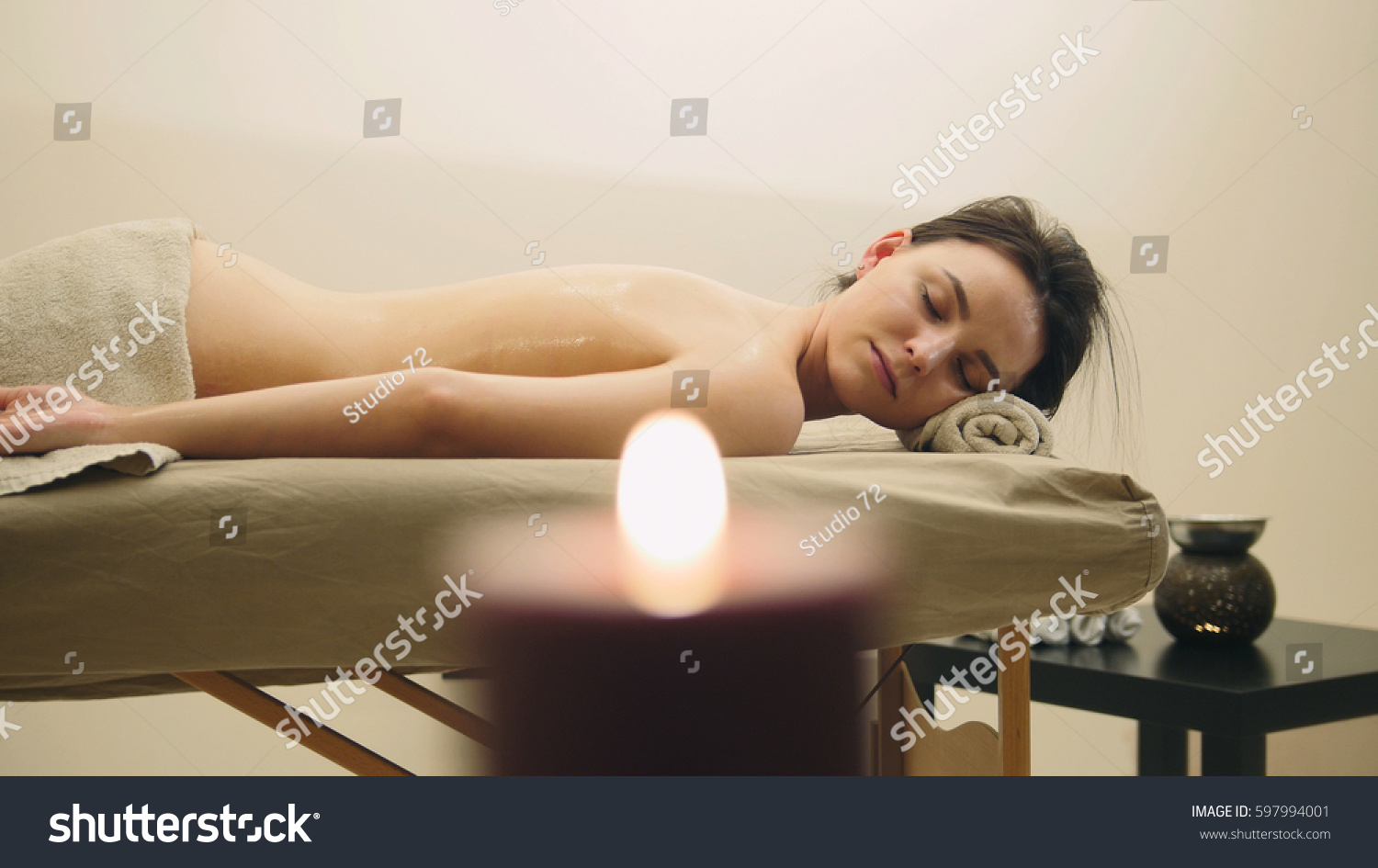 Oil relax massage - half nude young female on parlor, spa concept