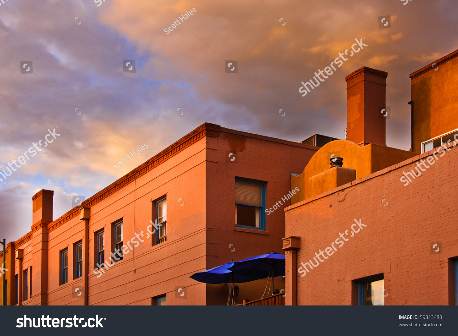 Terracotta brick and adobe roof tops at sunset stock for Adobe roof