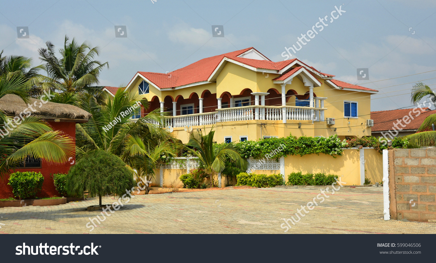 Beautiful photo of residential house in africa with balconies and a red tile roof housing
