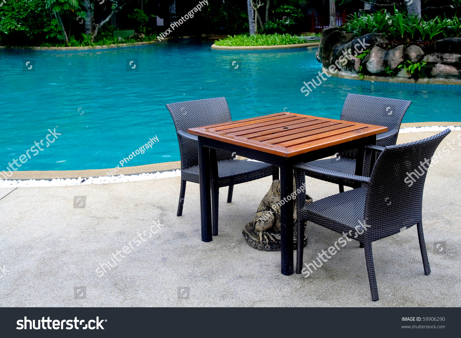 table chairs swimming pool stock photo