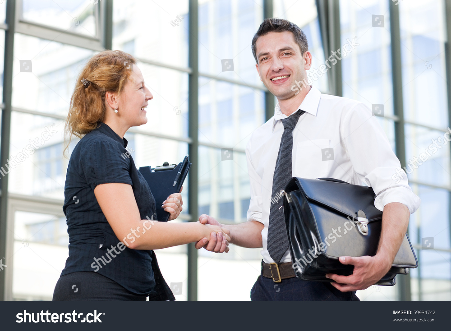 Happy Business People Greeting Each Other Stock Photo Edit Now