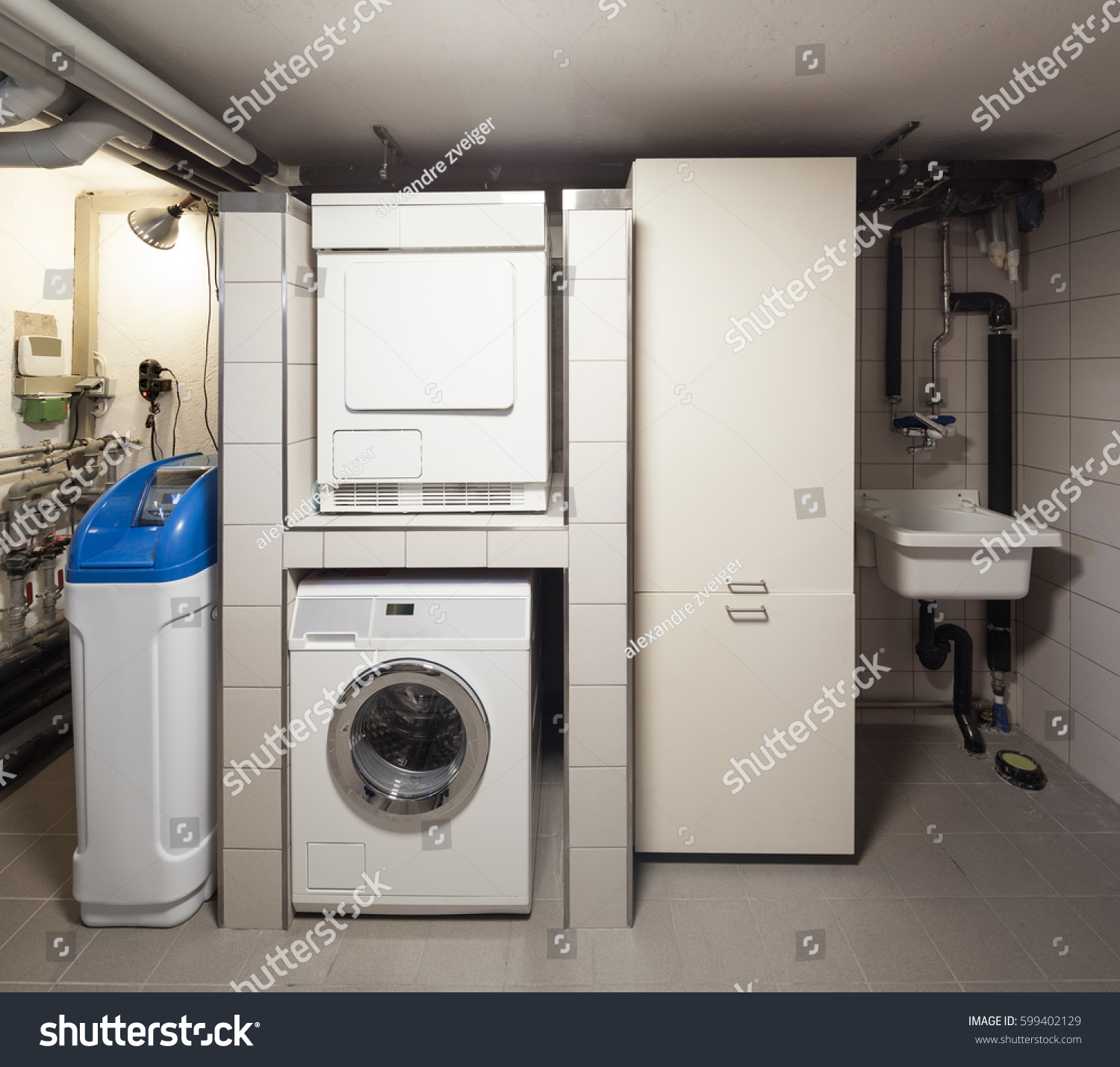 Basement Of An Apartment Block With Washing Machine For Common Use