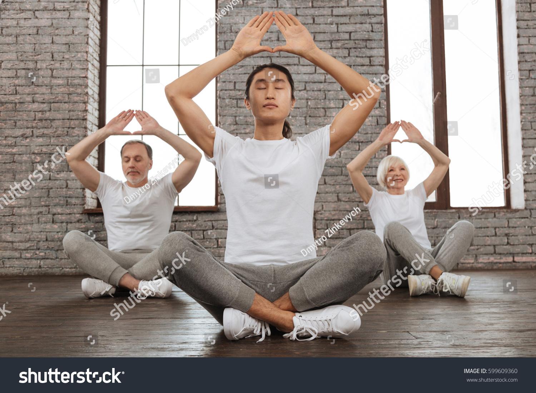 Three People Doing Yoga Poses Stock Photo Edit Now 599609360