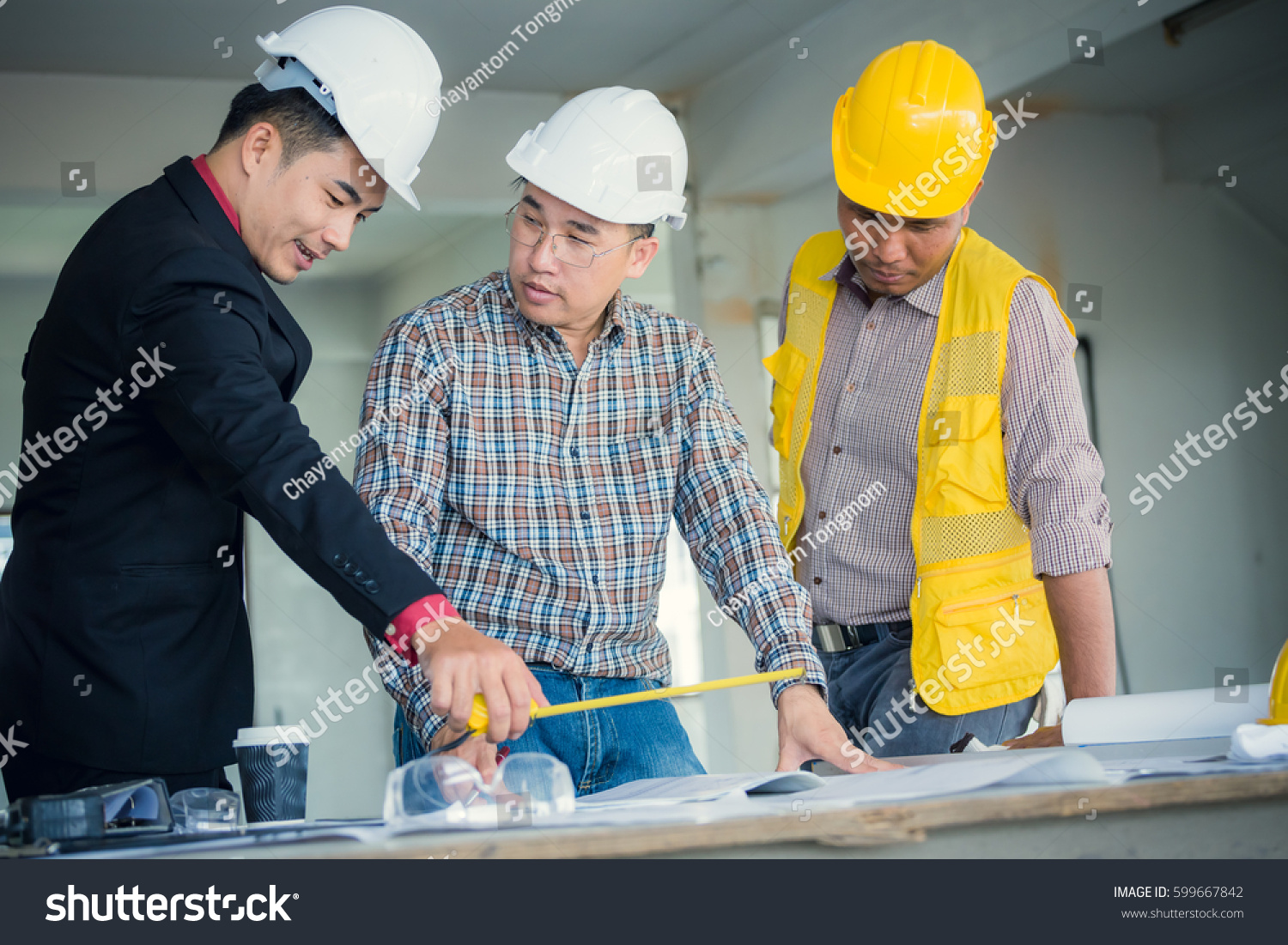Management consulting engineers foreman working blueprint stock management consulting and engineers and foreman working with blueprint and drawing on work table for management malvernweather Choice Image